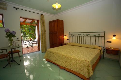 Letto o letti in una camera di Residence Hotel Villa Fiorentino