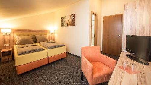 Ein Bett oder Betten in einem Zimmer der Unterkunft Hotel an der Waldstraße