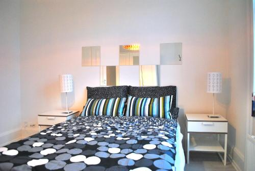 A bed or beds in a room at City View Apartment Copenhagen