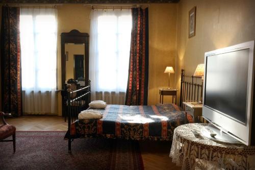 Łóżko lub łóżka w pokoju w obiekcie Austeria Klezmer Hois