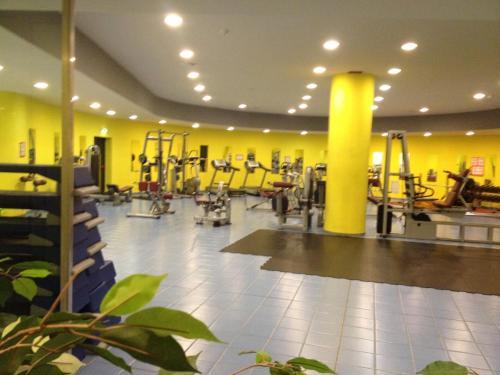 The fitness center and/or fitness facilities at Appartamento Villaggio Olimpico