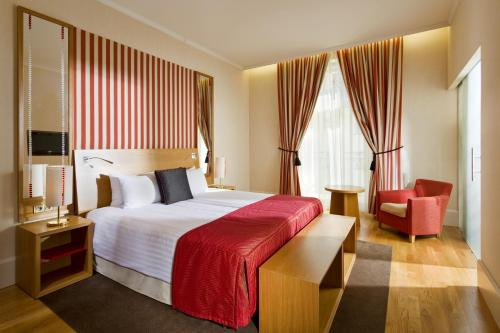 A bed or beds in a room at Mamaison Hotel Riverside Prague
