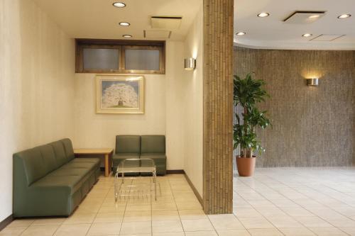 The lobby or reception area at Sankei City Hotel Chiba
