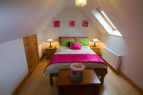 A bed or beds in a room at The Thatched Cottage B&B