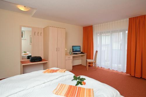 Ein Bett oder Betten in einem Zimmer der Unterkunft Müritzperle