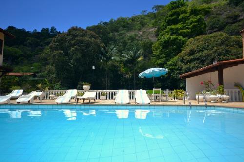 The swimming pool at or close to Vila da Sol Itaipava casas e estúdios