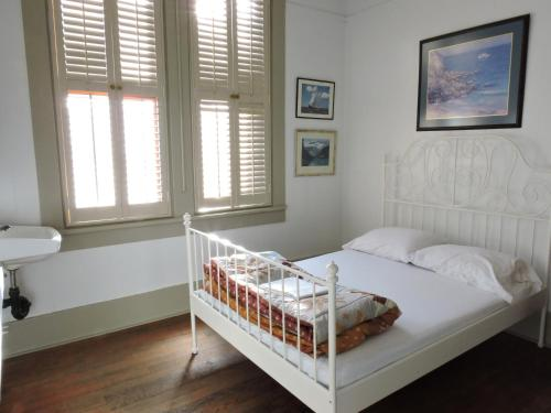 A bed or beds in a room at St. Clair Hotel Hostel