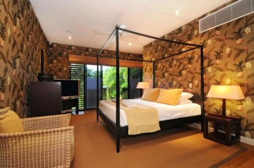 A bed or beds in a room at Bali House - Luxury Holiday Home