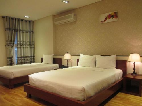 Giường trong phòng chung tại Anh Dao Mekong Hotel