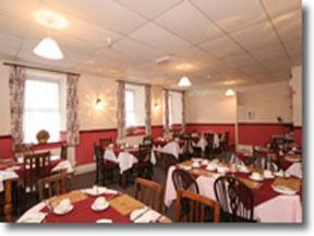 A restaurant or other place to eat at Portland Lodge