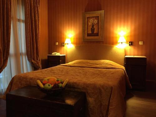 Ένα ή περισσότερα κρεβάτια σε δωμάτιο στο Rocabella Hellinikon Country Hotel