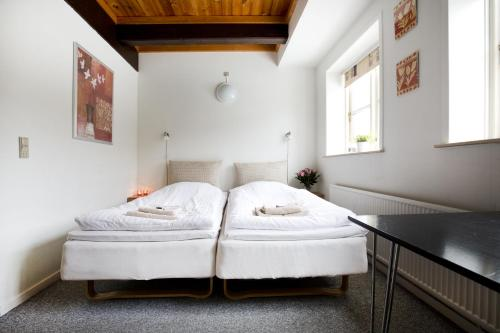 A bed or beds in a room at Motel Stege