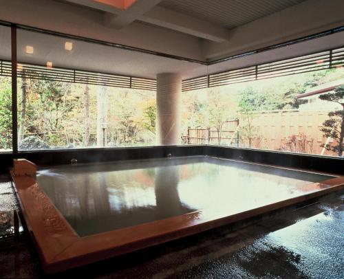 The swimming pool at or near Gensenkan