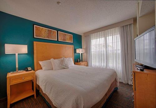 A bed or beds in a room at Residence Inn Neptune at Gateway Center