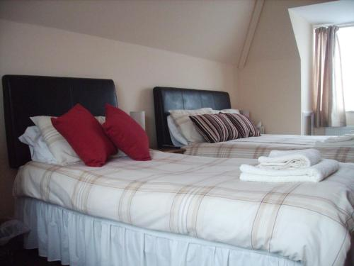 A bed or beds in a room at Singlecote
