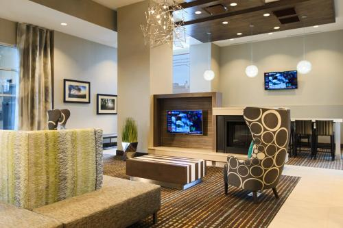 A television and/or entertainment center at Residence Inn by Marriott Nashville Vanderbilt/West End