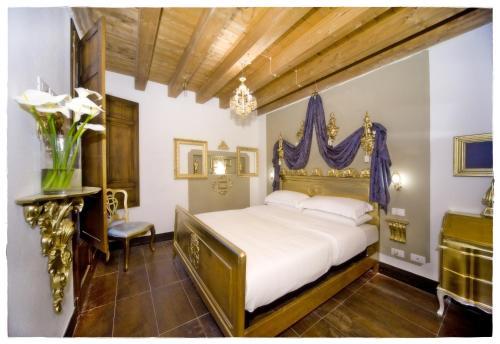 Letto o letti in una camera di The Place Cagliari