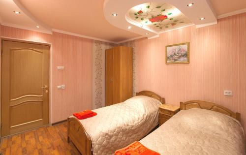 Кровать или кровати в номере Apart hotel 4 Rooms