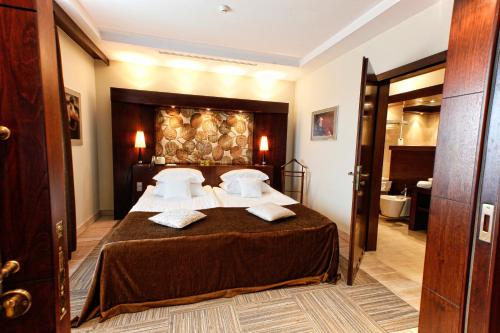 Łóżko lub łóżka w pokoju w obiekcie Hotel Rodan-Groklin