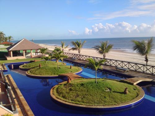 Uitzicht op het zwembad bij Cumbuco Ocean View of in de buurt