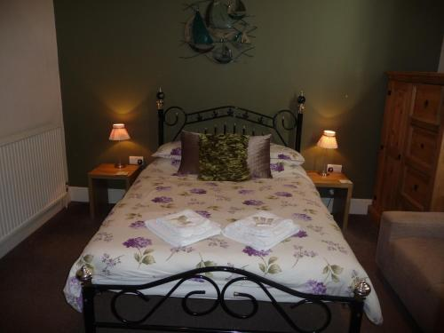 A bed or beds in a room at The Bernay