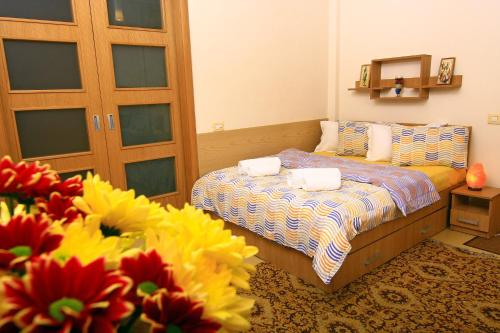 """A bed or beds in a room at """"Ateneu"""" Apartments"""