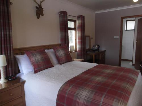 A bed or beds in a room at Foyers House