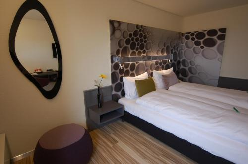 A bed or beds in a room at Hotel Thurgauerhof