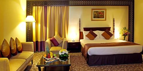 سرير أو أسرّة في غرفة في فندق كارلتون تاور