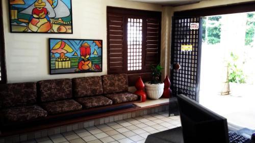 A seating area at Escuna Praia Hotel