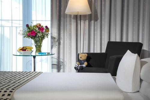 Ein Bett oder Betten in einem Zimmer der Unterkunft Dorint Sanssouci Berlin/Potsdam