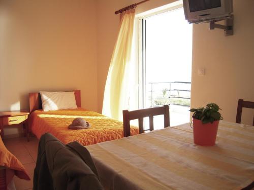 Ένα ή περισσότερα κρεβάτια σε δωμάτιο στο Sirius