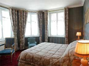 A bed or beds in a room at Les Lions De Beauclerc
