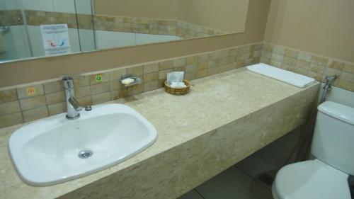 A bathroom at Apartamento Le Jardin - Suítes para Temporada