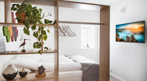 A bed or beds in a room at Island Apartments
