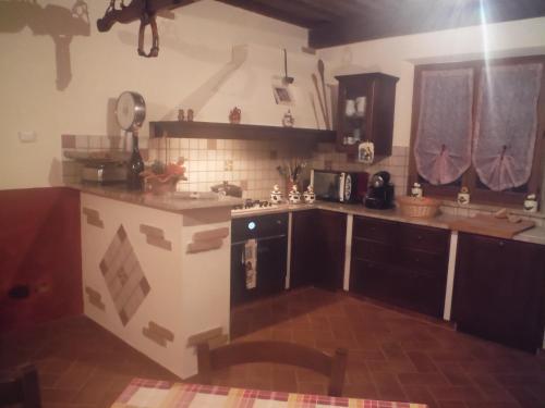 A kitchen or kitchenette at Agriturismo Santa Adriana