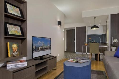 A television and/or entertainment center at Citadines Michel Hamburg