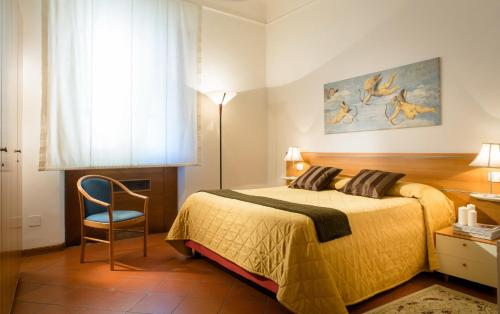 A bed or beds in a room at Residence San Niccolò