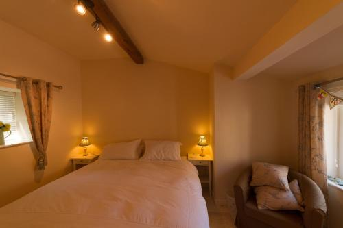 A bed or beds in a room at Pant Teg B & B