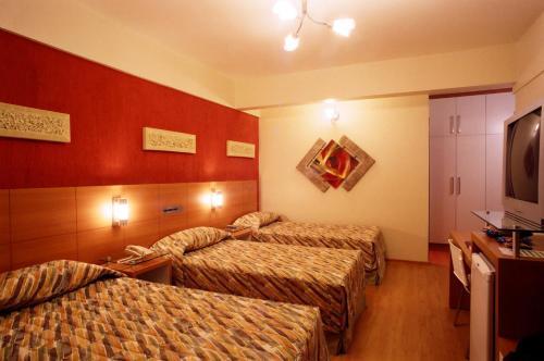 A bed or beds in a room at Líber Hotel Nova Serrana