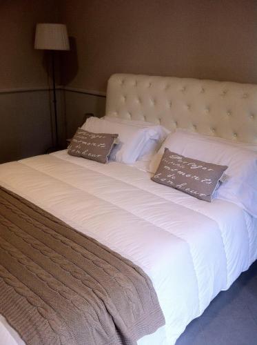 Un pat sau paturi într-o cameră la B&B Le Grazie