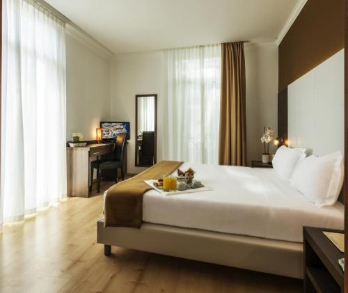 Un ou plusieurs lits dans un hébergement de l'établissement Ambassador-Monaco