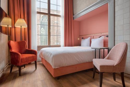 Een bed of bedden in een kamer bij Boutique Hotel The Roosevelt