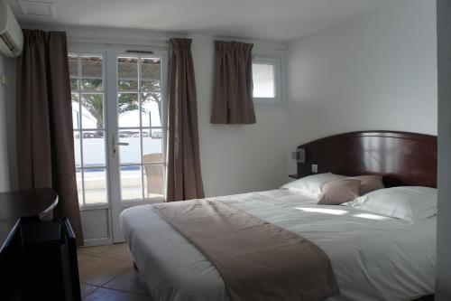 Un ou plusieurs lits dans un hébergement de l'établissement Agay Beach Hotel