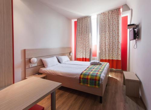 Кровать или кровати в номере Hotel Marenero