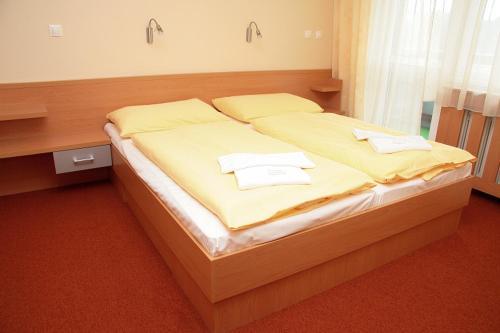 Posteľ alebo postele v izbe v ubytovaní Beskydsky Hotel Relax