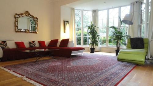 A seating area at The Old Rectory Apartment