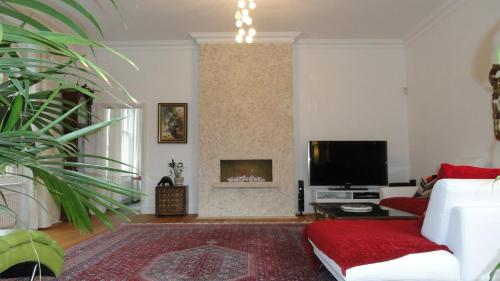 A television and/or entertainment center at The Old Rectory Apartment