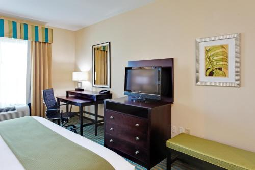A television and/or entertainment center at Holiday Inn Express Hotel & Suites Gulf Shores, an IHG Hotel