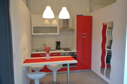 A kitchen or kitchenette at Apartments Peloža